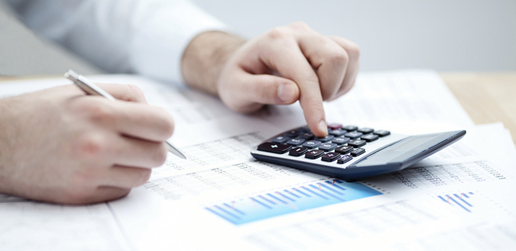 Manual accounting work in progress with calculator